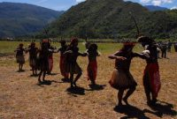Baliem Valley Festival Traditional War dance, man and woman, move their feet with rhytmics tribal sound.