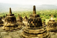 Borobudur, The monument is shaped like a mandala, forming a series of platforms – five square platforms below, four circular platforms above – riddled with a pathway that takes pilgrims through three levels of